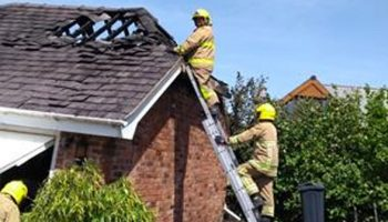 Firefighters tackle garage roof fire